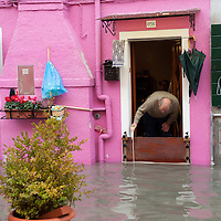 A local man keeps an eye on the rising water in Burano. More than 59% of Venice was under water on Thursday, as the historic lagoon town was hit by exceptionally high tides. The sea level rose above 140cm overnight and was expected to remain above critical levels for about 15 hours.