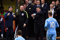 27 November 2016 - Premier League - Watford v Stoke City - Walter Mazzarri manager of Watford taps his watch as Marko Arnautovic of Stoke City takes a long time to leave the pitch - Photo: Marc Atkins / Offside.
