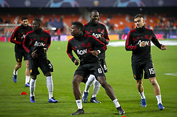 Manchester United's Paul Pogba (centre) warms up ahead of the match