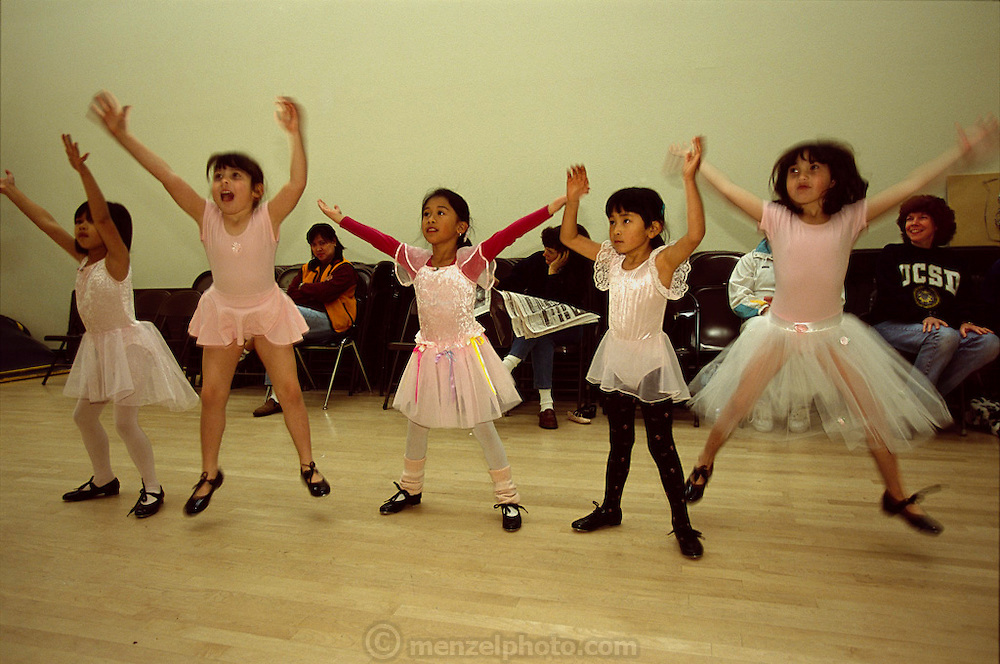 Jumping for joy, Andrea Caven (second from left) works through the routines in her ballet class at the American Canyon Community Center. Parents (Regan on right, in UCSD sweatshirt) benevolently supervise from chairs along the wall. Hungry Planet: What the World Eats (p. 265).