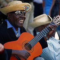 Central America, Cuba, Havana. Los Mambises Guitar Player in Old Havana.