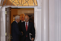 Vice President-elect Mike Pence shakes hands with Andrew Puzder, chief executive of CKE Restaurants, after meeting with President-elect Donald Trump (C), while leaving the clubhouse of Trump International Golf Club, November 19, 2016 in Bedminster Township, New Jersey. (Aude Guerrucci / Pool)