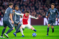 12-12-2018 NED: Champions League AFC Ajax - FC Bayern Munchen, Amsterdam<br /> Match day 6 Group E - Ajax - Bayern Munchen 3-3 / (L-R) Niklas Sule #4 of Bayern Munich, Jerome Boateng #17 of Bayern Munich, Dusan Tadic #10 of Ajax, Leon Goretzka #18 of Bayern Munich