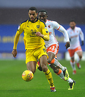 Oxford United's Curtis Nelson under pressure from Blackpool's Joe Dodoo<br /> <br /> Photographer Kevin Barnes/CameraSport<br /> <br /> The EFL Sky Bet League One - Oxford United v Blackpool - Saturday 15th December 2018 - Kassam Stadium - Oxford<br /> <br /> World Copyright © 2018 CameraSport. All rights reserved. 43 Linden Ave. Countesthorpe. Leicester. England. LE8 5PG - Tel: +44 (0) 116 277 4147 - admin@camerasport.com - www.camerasport.com
