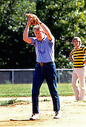 President Jimmy Carter pitching in a softball game at the Plains High school in his hometown of Plains, Georgia.
