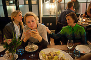 BAY GARNETT; EVIE HUDSON Leaving dinner for Kate Phelan given by Alex Shulman and Mary Homer. Riding House Cafe. Great Titchfield st. London. 20 September 2011. <br /> <br />  , -DO NOT ARCHIVE-© Copyright Photograph by Dafydd Jones. 248 Clapham Rd. London SW9 0PZ. Tel 0207 820 0771. www.dafjones.com.