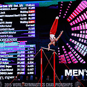 Kohei Uchimura of Japan performs on the Horizontal Bar at the 46th FIG Artistic Gymnastics World Championships in Glasgow, Britain, 25 October 2015.