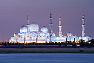 Dusk view of the Sheikh Zayed Grand Mosque in Abu Dhabi, capital of the United Arab Emirates.