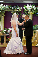 5th June 2010. Las Vegas, Nevada. Known around the world as one of the most Famous places to be married, The Little White Wedding Chapel in Las Vegas has wed stars from Britney Spears to Judy Garland. Pictured is Ashley Jacobsen, 25, and her groom Paul Yoder, 23, from Oceanside, CA. Paul turned up an hour late after mislaying a crucial bit of paperwork. PHOTO © JOHN CHAPPLE / www.chapple.biz.john@chapple.biz  (001) 310 570 9100.