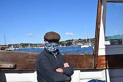 Man wearing face mask on Falmouth to Flushing foot ferry, Cornwall UK Oct 2020. MR