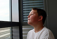 Zachary Frantzen, 10, waits for a counseling session as part of the Shapedown Program at The Children's Hospital in Aurora, Colorado July 8, 2010.  Shapedown is part of the child and teen weight management programs at the hospital.  REUTERS/Rick Wilking (UNITED STATES)