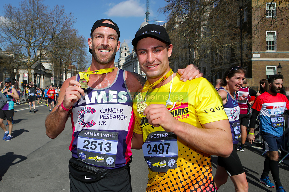 Competitiors James Ingh (left) and Frankie Foster pose with medlals during the 2019 London Landmarks Half Marathon.