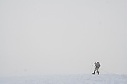 Jim Prager crosses a glacier in heavy fog on the Eldorado Icecap, North Cascades National Park, Washington.