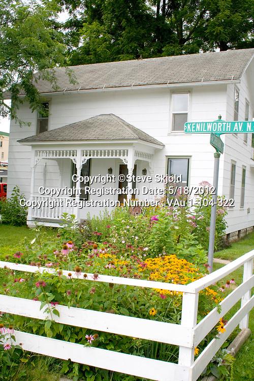 Lovely residential home tucked behind white fence and flower garden. Lanesboro Minnesota MN USA