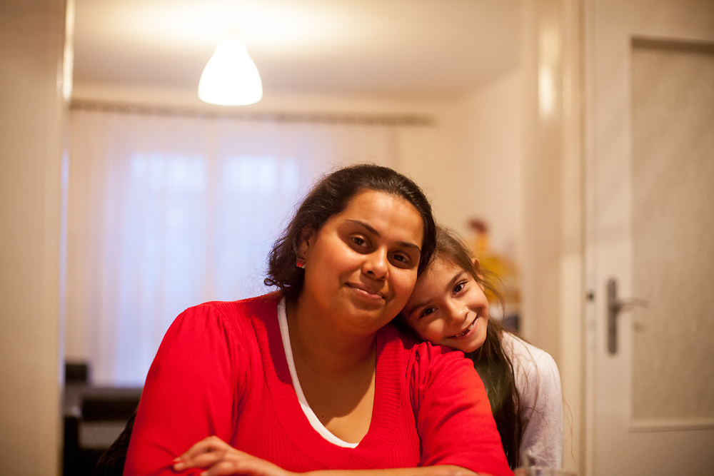 Portrait of mother and volunteer Anastazie Baudycka (28) with her daughter Nikola Holubova (6) during a meeting with volunteers and mothers with their children for consultation and data collection regarding school enrolments in Ostrava. The meeting was in a volunteers flat.
