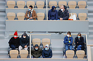The spectators and supporters are dressed as in winter equipped with caps, scarves, jackets, folded up on themselves seized by the cold and wet wind inside Philippe Chatrier stadium during the Roland Garros 2020, Grand Slam tennis tournament, on October 5, 2020 at Roland Garros stadium in Paris, France - Photo Stephane Allaman / ProSportsImages / DPPI