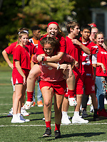 """The senior girls """"piggy back"""" team is all smiles during the Homecoming Pep Rally at Laconia High School Friday afternoon.   (Karen Bobotas/for the Laconia Daily Sun)"""