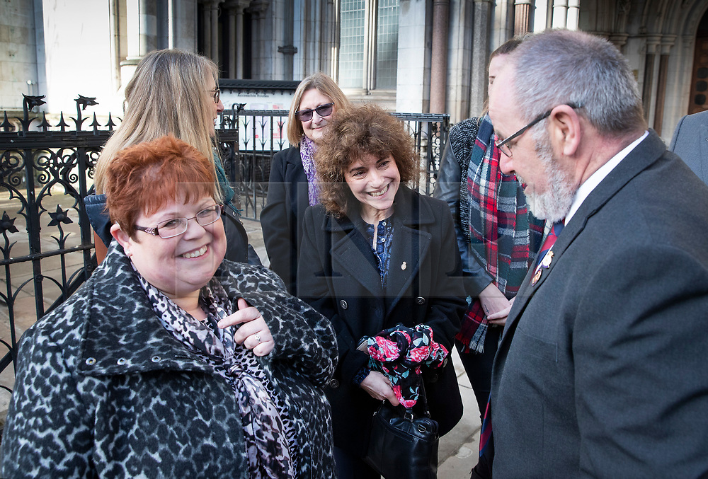 © Licensed to London News Pictures. 18/12/2019. London, UK. Relatives and survivors of the 1982 IRA Hyde Park Bomb Vincenzo Latino (R) stands with SarahJane Young (L) and Louise Tipper (C) at The High Court where they and other family members have won a ruling in a civil case against convicted IRA member John Downey. The court has ruled that John Downey was an active participant in the bombing.  The Hyde Park bombing in July 1982 killed Squadron Quartermaster Corporal Roy Bright, Lieutenant Anthony Daly, Lance Corporal Jeffrey Young and Trooper Simon Tipper. Photo credit: Peter Macdiarmid/LNP