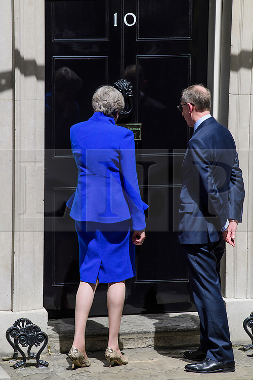 © Licensed to London News Pictures. 09/06/2017. London, UK. British prime minister  THERESA MAY and her husband PHILIP MAY arrive back at 10 Downing Street in London, following a meeting with Queen Elizabeth II, in which she asked to form a new government. The Conservative Party made substantial losses in an election that they were expected to win comfortably. Photo credit: Ben Cawthra/LNP