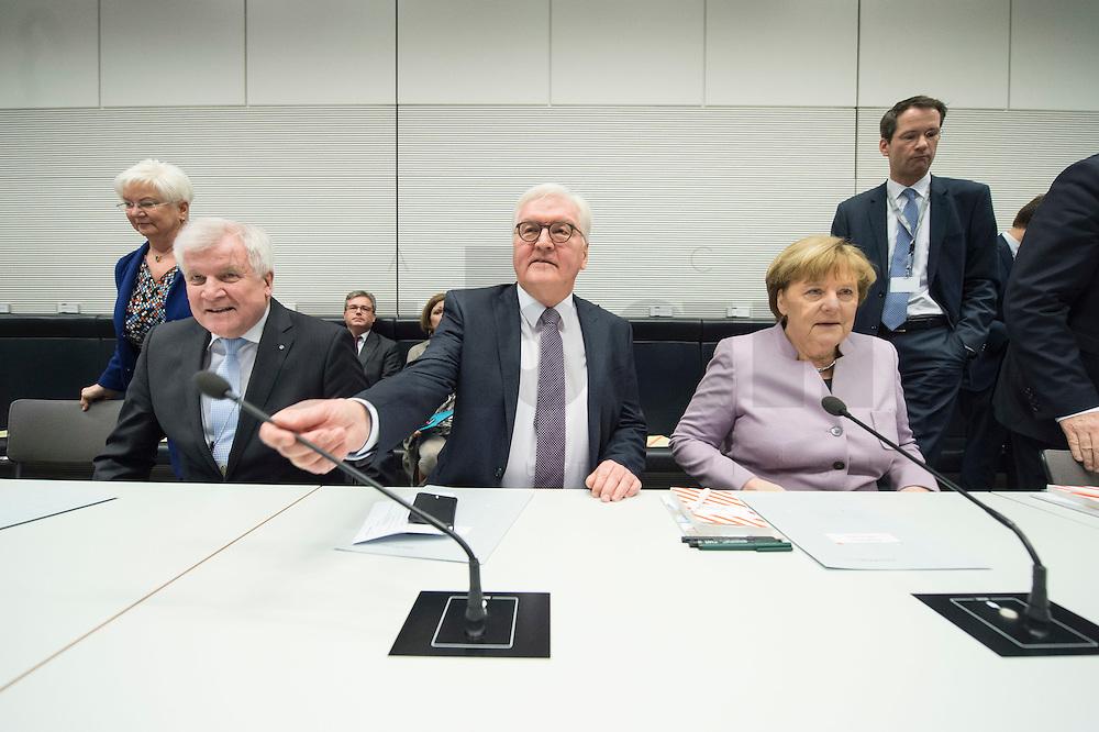 11 FEB 2017, BERLIN/GERMANY:<br /> Horst Seehofer, CSU, Ministerpraesident Bayern, Frank-Walter Steinmeier, SPD, Kandidat fuer das Amt des Bundespraesidenten, Angela Merkel, CDU, Bundeskanzlerin, (v.L.n.R.), vor Beginn der CDU/CSU Fraktionssitzung am Vortag der Bundesversammlung, Reichstagsgebaeude, Deutscher Bundestag<br /> IMAGE: 20170211-01-010