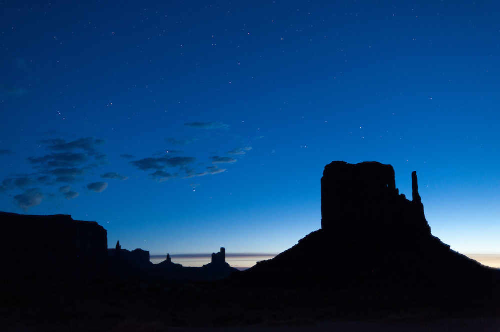 The final stars of the night remain as dawn rises, Monument Valley
