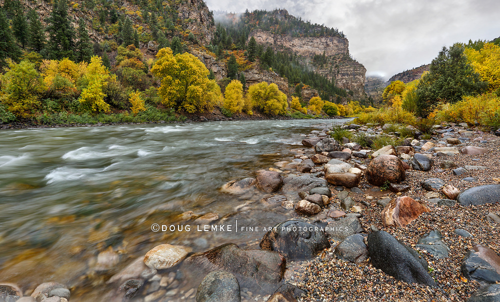 Autumn colors along the Colorado River at Glenwood Springs in the Colorado Rockies, USA