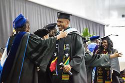 Graduates Shawn G. Seabrookes and Elisa Monie'e Thomas receive their degree.  Fifty-first annual University of the Virgin Islands  Commencement Exercises.  UVI Sports & Fitness Center.  St. Thomas, VI.  14 May 2015.  © Aisha-Zakiya Boyd