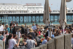 © Licensed to London News Pictures.04/05/2014. Brighton, UK. Thousands of people are visiting Brighton and sunbathing on the beach during the May bank holiday weekend. Photo credit : Hugo Michiels. Photo credit : Hugo Michiels