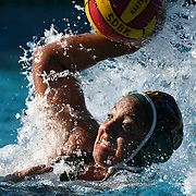 #13 Mayra Garcia-Cortez, Driver for Golden West College, launches the ball in the first round win over Santa Anna College 21-3 of the Orange Empire Conference water polo championships. November 3rd, 2016.