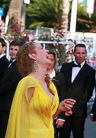 Uma Thurman enjoying Quentin Tarantino dancing on the red carpet at Sils Maria gala screening at the 67th Cannes Film Festival France. Friday 23rd May 2014 in Cannes Film Festival, France.