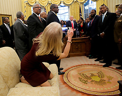 Counselor to the President Kellyanne Conway takes a picture of U.S. President Donald Trump with members of the Historically Black Colleges and Universities in the Oval Office of the White House, Washington, DC, February 27, 2017. (Pool / Aude Guerrucci)