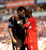 Photo: Jed Wee, Digitalsport<br /> Liverpool v Sunderland. The Barclays Premiership.<br /> 20/08/2005.<br /> <br /> Sunderland's Gary Breen (L) squares up to Liverpool's Djibril <br /> Norway only