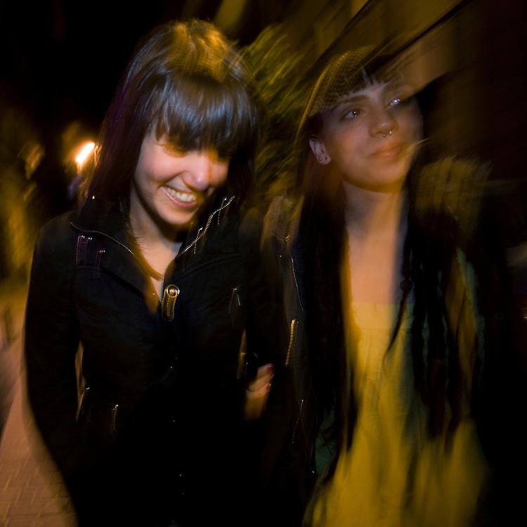 2:07 AM: Marta Selgas Díaz,23, physiotherapy student, and Ángela Hermosa García, 23, internet marketing influencer, walk on San Bernardo street, in Madrid, while enjoying the citi's famous nightlife...