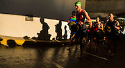 Athletes run up the helix at Monona Terrace to transition during the Ironman Wisconsin triathlon. (Photo © Andy Manis)