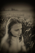Young girl alone in a field