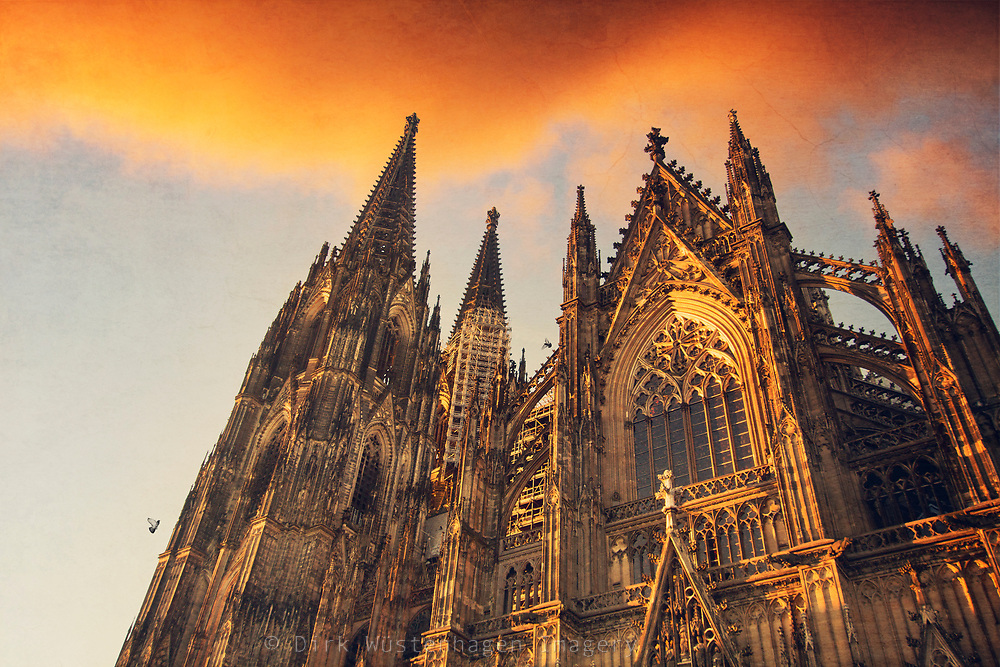 South side of the famous cathedral in Cologne on a sunny evening in autumn. Photograph edited with texture overlays