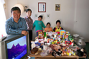 The Madsen family in their living room in Cap Hope village, Greenland, with a week's worth of food. Standing by the TV are Emil Madsen, 40, and Erika Madsen, 26, with their children (left to right) Martin, 9, Belissa, 6, and Abraham, 12. From the book Hungry Planet: What the World Eats (Model Released)