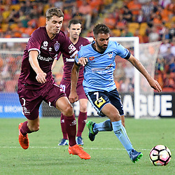 BRISBANE, AUSTRALIA - NOVEMBER 19: Thomas Kristensen of the Roar and Michael Zullo of Sydney compete for the ball during the round 7 Hyundai A-League match between the Brisbane Roar and Sydney FC at Suncorp Stadium on November 19, 2016 in Brisbane, Australia. (Photo by Patrick Kearney/Brisbane Roar)