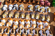Nodding dogs for sale at Chiang Dao twice monthly morning market, Chiang Mai province, Thailand. Local hill tribes throng to the market to sell their products and buy necessities.