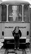 Skater riding a tram through central Sophia. Bulgaria. April 1989