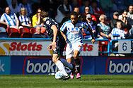 Sean Scannell of Huddersfield Town looks to go past Stephen Warnock of Derby County. Skybet football league championship match, Huddersfield Town v Derby county at the John Smith's stadium in Huddersfield, Yorkshire on Saturday 18th April 2015.<br /> pic by Chris Stading, Andrew Orchard sports photography.