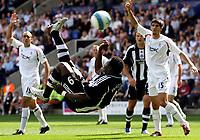 Photo: Paul Thomas. <br /> Bolton Wanderers v Newcastle United. Barclays Premiership. 11/08/2007. <br /> <br /> Obafemi Martins (C) scores for Newcastle.