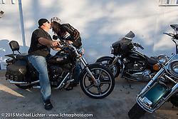 Mariah Dees and Mike Collette of Lakeland, FL outside the Iron Horse Saloon in Ormond Beach during Daytona Beach Bike Week 2015, FL, USA. Tuesday March 10, 2015.  Photography ©2015 Michael Lichter.