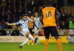 Huddersfield Town's Conor Coady scores his sides third goal to make it 0 - 3 - Photo mandatory by-line: Dougie Allward/JMP - Mobile: 07966 386802 - 01/10/2014 - SPORT - Football - Wolverhampton - Molineux Stadium - Wolverhampton Wonderers v Huddersfield Town - Sky Bet Championship