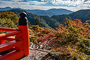 Kurama-dera is a peaceful Buddhist temple along the steep wooded mountainside above the rural town of Kurama, in the northern mountains of Kyoto City (Kyoto-fu), Japan. A cablecar takes you halfway up the mountain.  In September 2018, a typhoon snapped trees and extensively damaged the grounds of Kurama Temple. During our visit in November, the cablecar was required to reach walking trails to the main hall; and the steep 1-hour hiking trail between Kurama and Kibune was closed until further notice.
