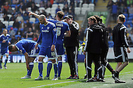 Outgoing Cardiff City manager Russell Slade (cap) gives instructions to his players during a break in play in his last match as manager as it was announced yesterday that he is to be moved upstairs for his new post as Director of Football..  . Skybet football league championship match, Cardiff city v Birmingham city at the Cardiff city stadium in Cardiff, South Wales on Saturday 7th May 2016.<br /> pic by Carl Robertson, Andrew Orchard sports photography.