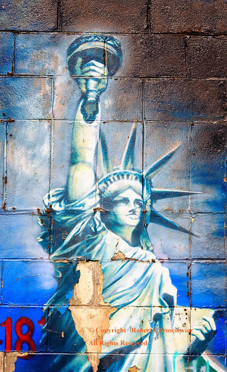 Tattered Dream: A rather worn and tattered painting of the Statue of Liberty, which is rather fitting, given the present state of the union, Vancouver British Columbia Canada.