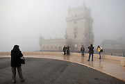 Despite the foggy morning, tourists pose and take pictures at Belem's Tower. The area of Belem's Tower attracts lots of visitors, both tourists and locals, because of its beauty and peacefulness. Belem's Tower was built in the fifteenth century (1514-1520) as a military fortification. It was recognized as a UNESCO World Heritage Site in 1983.