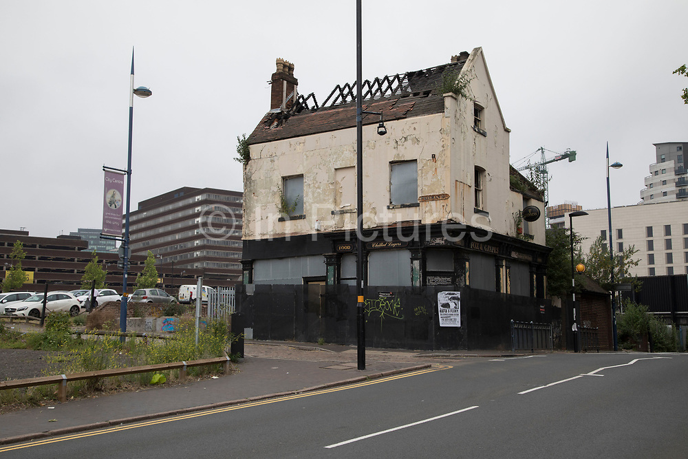 Closed down and derelict Fox and Grapes public house near to the Bullring in Birmingham, United Kingdom. The Fox and Grapes Pub is one of Birmingham's oldest pubs, and now is under proposed demolition plans under the probable construction of HS2. The grade-II star listed building was constructed on Freeman Street in Digbeth in 1724 and 1725. Most of its structure and facade was altered in the mid-19th century, so it's current look defies it's age.