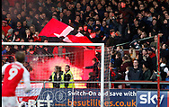 Fleetwood fans let a flare off during the EFL Sky Bet League 1 match between Fleetwood Town and Blackpool at the Highbury Stadium, Fleetwood, England on 25 November 2017. Photo by Paul Thompson.
